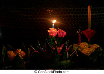 Two candles in krathong in Loy Krathong Festival