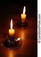 Two Candles - Two candles on a wood table