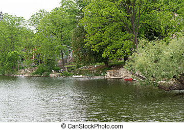 Two canoes  near the house on the river