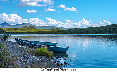 Two Canoes on the Shore