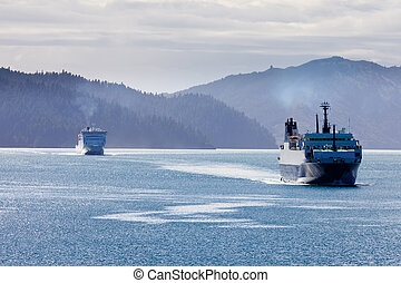 Huge car ferry ships in calm water of Marlborough Sounds, South Island, New Zealand