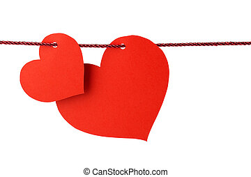 two cards in the shape of heart hanging from a red cord