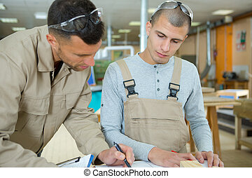 two carpenters are at work