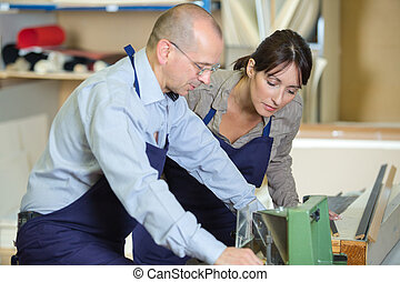 two carpenters cooperating with each other and working