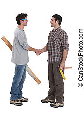 Two carpenters greeting each other