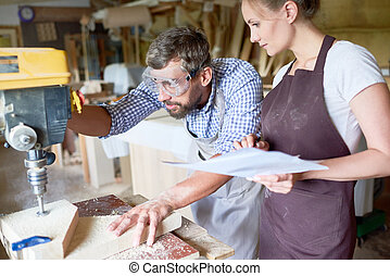 Two Carpenters in Workshop