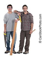 Two carpenters stood with plank of wood