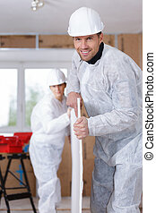 two carpenters working at location