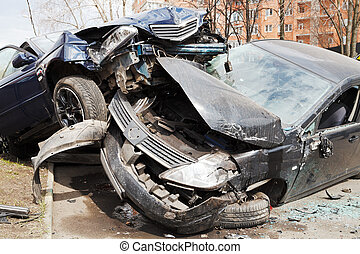 two cars car broken during road accident