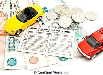 two cars, driving license and banknotes