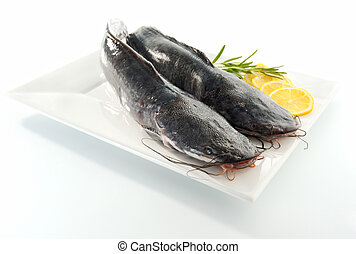 Two catfishes on a plate.