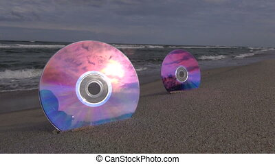 Two CDs on the beach