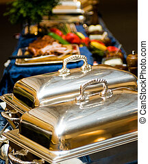 Two chafing dishes - Two closed chafing dishes at a banquet