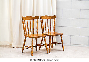 Two chair White wall