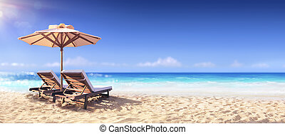 Two Chairs And Parasol On The Golden Beach