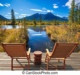 Two chairs and round table on the lake - Two comfortable...