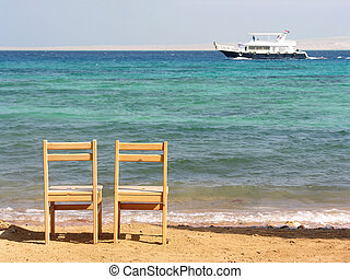two chairs on beach -           two chairs on beach
