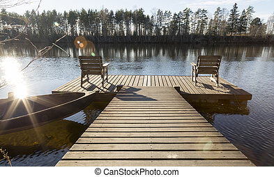 Two Chairs on Pier in River