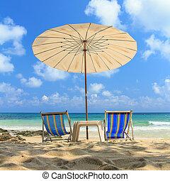 two chairs umbrella beach