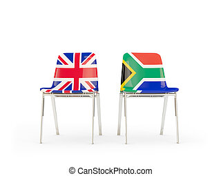 Two chairs with flags of UK and south africa isolated on white