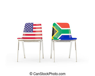 Two chairs with flags of US and south africa isolated on white