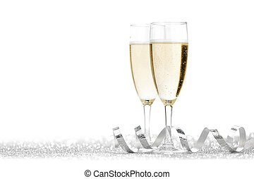 Two champagne glasses and silver ribbon on white background