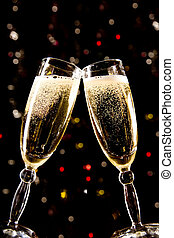 Two champagne glasses making toast over holiday background