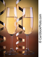 Two champagne glasses, on golden background