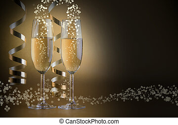 Two champagne glasses, on golden bokeh background