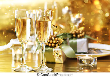 Two champagne glasses on the dinner table