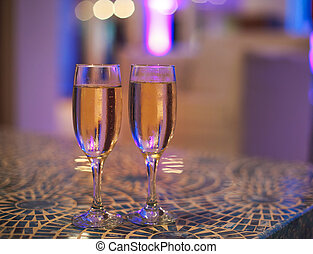 Two champagne glasses on the table
