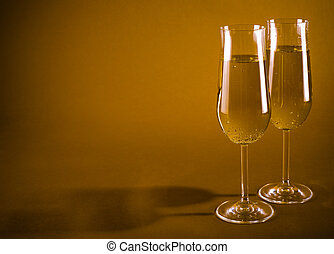 two champagne glasses - pair of glasses filled with bubbly...