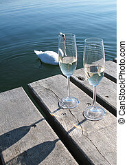 Two champagne on a wooden jetty