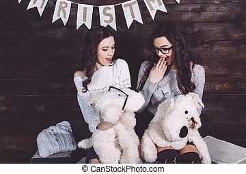 Two charming girls playing