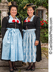 Two charming ladies in traditional