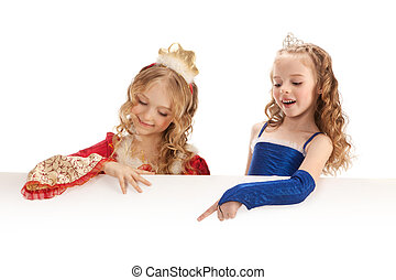 Two Charming Little Princesses Holding Big Banner