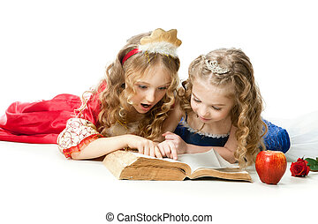 Two Charming Little Princesses Reading The Magic Book