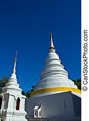 Two Chedi 's at Wat Phra Singh with blue sky