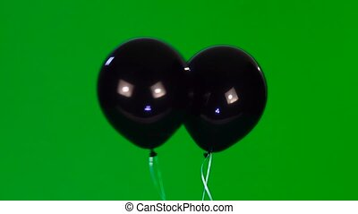 balloon - two cheerful black balloon with eyes and a smile...