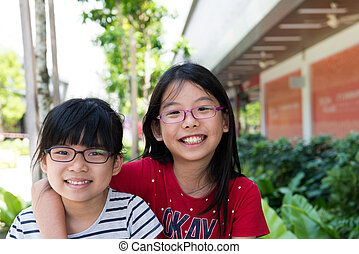 Two cheerful sister child