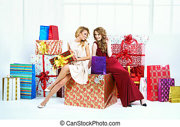 Two cheerful women with presents