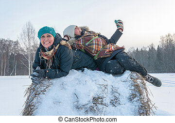 Two cheerful young women on a haystack. - Two cheerful young...