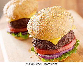 two cheeseburgers in natural light.