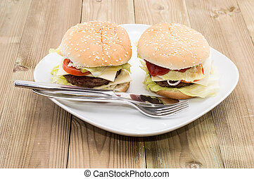 Two Cheeseburgers on a plate