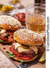Two cheeseburgers on sesame buns