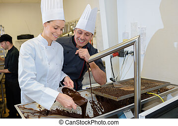 two chefs in a cooking school