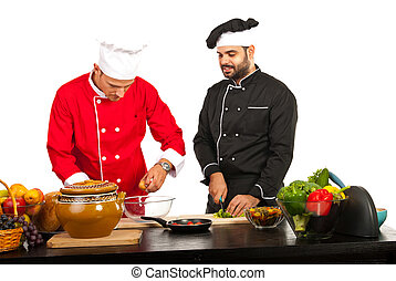 Two chefs preparing food