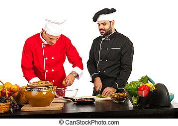 Two chefs preparing food