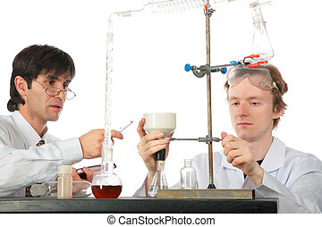 Two chemists with chemical equipment