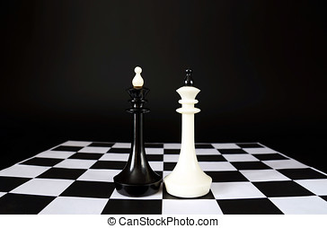 Two chess kings. Battle of equal competitors. Concept with...
